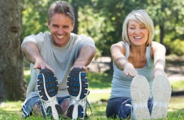 Image of mature athletic couple stretching - used to illustrate Dr. Varkey's specialty of knee, shoulder, hip and elbow arthroscopy