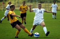 Image of two female soccer players - used to show that Dr. Varkey performs ACL reconstruction