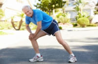 Image of older man stretching to prevent sports injuries